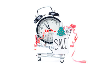 Picture of trolley with gold alarm clock, Christmas tree, greeting card, ribbon