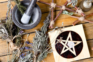 Herb Witch workings with Mortar and Pestle, pentacle altar tile with dried herb bundles, and brass...