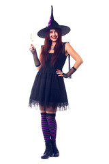 Image of smiling witch with wine glass with wine in black dress and hat