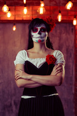 Image of woman zombie with white make-up on her face, sewn on her mouth
