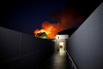 Flames rise after a rocket attack in Sderot, near the Israeli side of the Israel-Gaza border