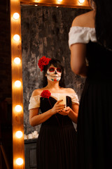 Grim halloween image of zombie girl with white face