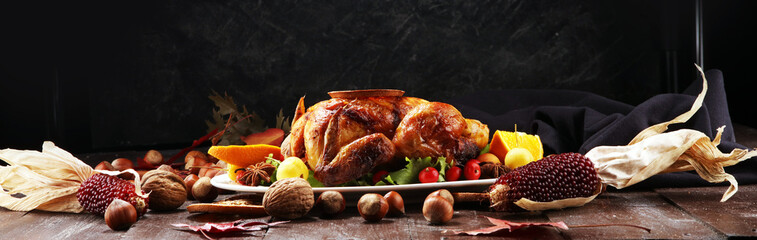 Baked turkey or chicken. The Christmas table is served with a turkey, decorated with fruits, salad and nuts. Fried chicken, table. Christmas dinner