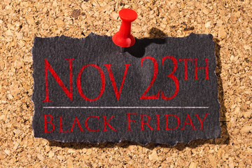 Cork panel. Red thumbtack, black paper: Black Friday concept. Text: 23th Black Friday