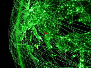 Kosovo from space on green model of Earth with international networks. Concept of green communication or travel.