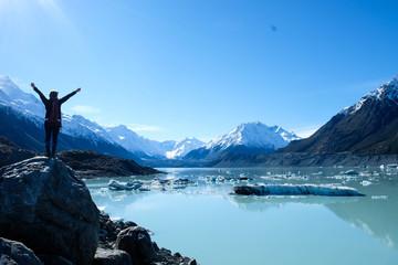 Traveling girl at the Tasman glacier lake, New Zealand