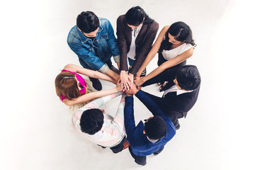 Top view of successful of group business people stack and putting their hands together at office.Friendship teamwork concept