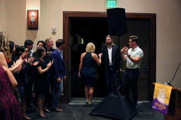 Democratic candidate Kyrsten Sinema fist-bumps her campaign manager after she spoke to supporters in Scottsdale