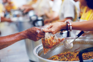Charity food is the hope of the poor who have no money: concept of begging food