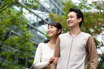young asian couple walking
