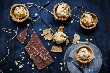 Overhead view of white chocolate ice cream in chocolate chip cookie bowls