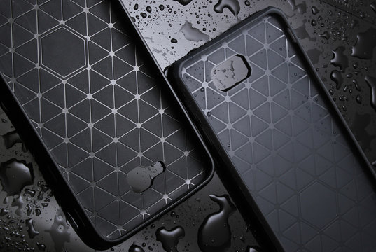 Protective smartphone cases on black background  with water drops.  Protect your smartphone from water.