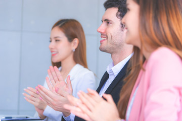 Business team is clapping applaud for successful meeting