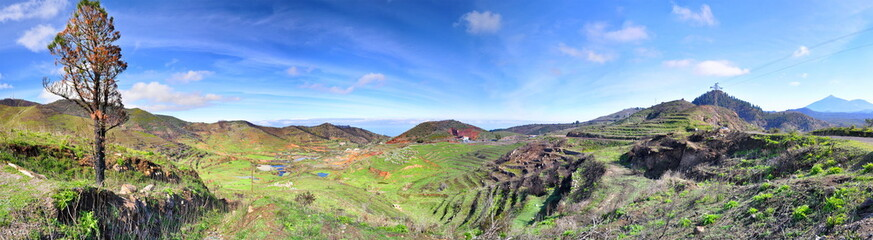 Green hills with blue sky on mountain plateau, Panorama, Tenerife, Canarian Islands