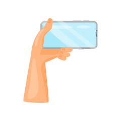 Human left hand holding mobile phone horizontally. Modern gadget. Smartphone with blue screen. Flat vector icon
