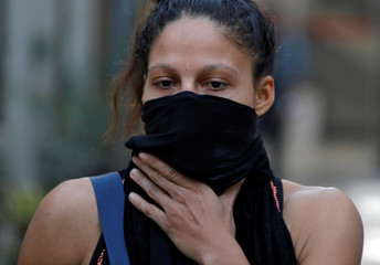 Colombian boxer Cordero covers her face with cloth in New Delhi