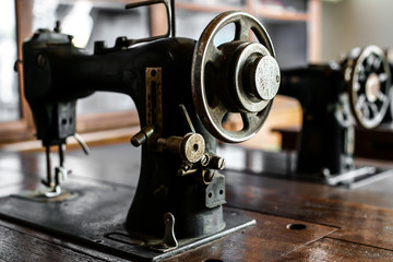 Ancient sewing machine Placed in an old-fashioned house in Thailand.soft focus.