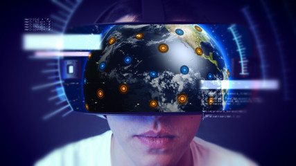 Young man wearing VR headset and experiencing virtual reality. Technology related digital earth network concept.