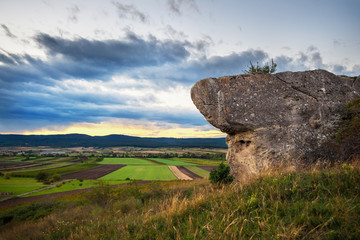 Landscape with boulder on a hill and small village in Burgenland austria
