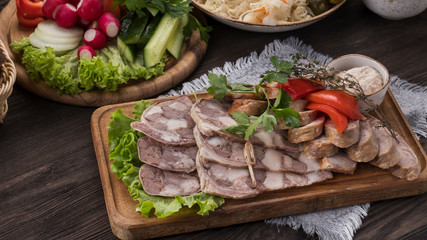 Sliced pork saltisons with homemade sausage on cutting board. Copyspace
