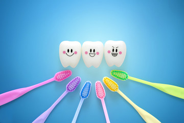Toys teeth dental in a smiling mood with tooth brush colorful on blue background, With Clipping path