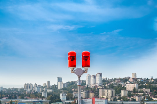 red lights on the roof of a high-rise building for the safety of buildings and air transport