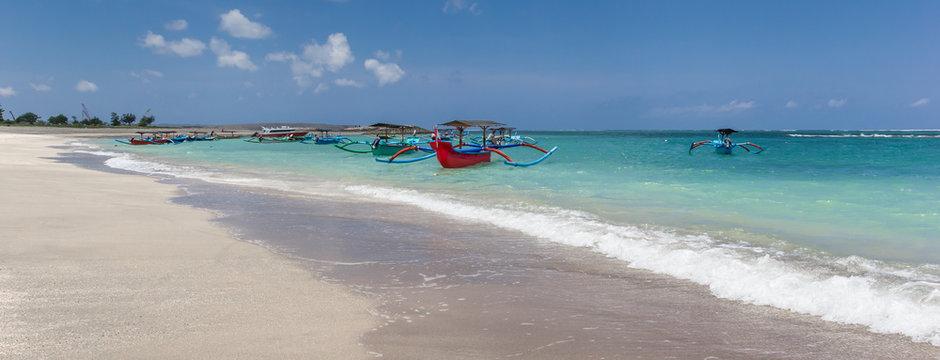 Panorama of the white sandy beach of Kuta. Indonesia