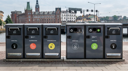 Trash containers for different rubbish in center of Stockholm, Sweden. Waste collection in Europe for subsequent recycling, eco friendly waste collection