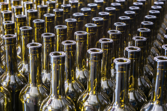 Wine bottles background, winemaking process to preparing wine for bottling in a winery