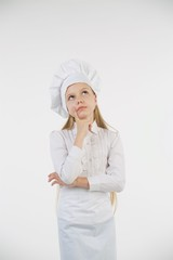 School-age girl dressed as a cook in white.