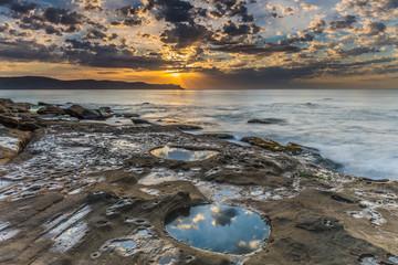 Cloud Reflections and a Coastal Sunrise