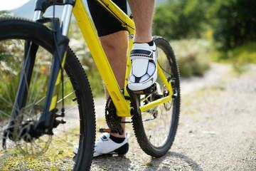 Closeup of a man wearing cycling shoes