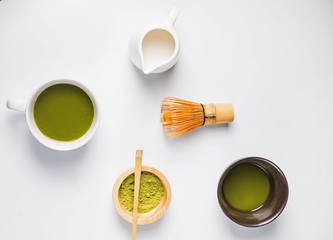 Wall Mural - Powder, green tea and milk on the white background, top view