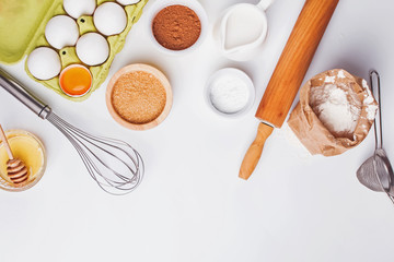 Tools and ingredients for baking: flour, eggs, sugar and other.