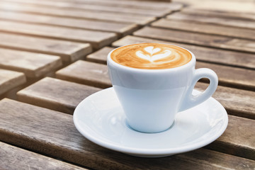 Fotobehang - Cup of fresh cappuchino with heart drawn on the foam