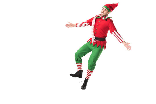 cheerful man in christmas elf costume jumping isolated on white background