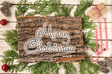 MERRY CHRISTMAS handwritten inscription. Winter holiday composi