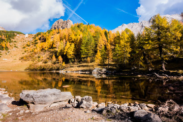 Colorful autumn landscape mountain. Mountains, lake and colrful trees