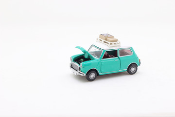a scale of Mini Coopers of toy display