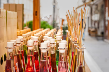 Bottles of fragrances with sticks for the fragrance of the house.