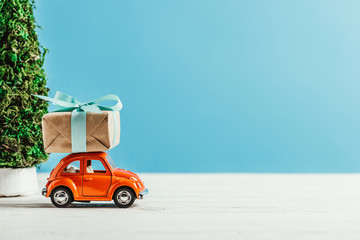 close-up shot of toy vehicle with gift box on blue background