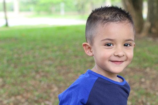 Hispanic child smiling in the park