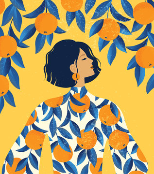 Beautiful girl in a dress with oranges pattern print and a orange tree background.