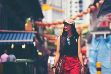 Asian travelers in Bugis Street Market, Singapore