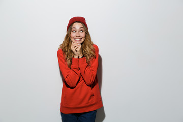 Excited young woman posing isolated over grey wall background.