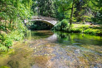 Bridge over river Kamenice in Bohemian Switzerland National Park, Czech Republic.