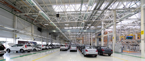 new car is at factory. Warehouse of cars. Modern car Assembly at factory