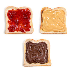 Fresh toast bread or toasted wheat bread slices. Strawberry jam, peanut butter and chocolate cream toast bread, isolated on white background.