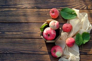 Fresh organic apples on wooden background. Apple harvest.