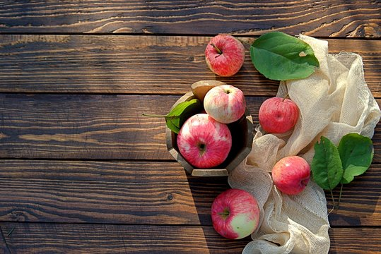 Fresh organic apples on wooden background. Apple harvest.